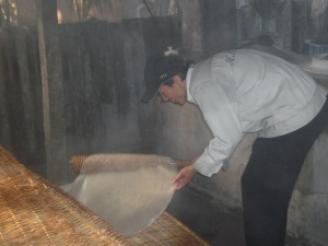 Step Four: Placing the hot rice disc on the drying racks
