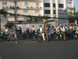 A sea of scooters at an intersection in Can Tho